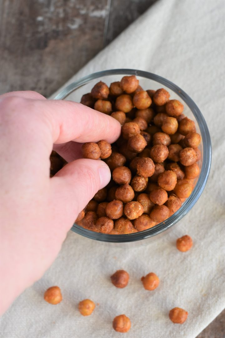 Grabbing some of the Buffalo chickpeas from the bowl