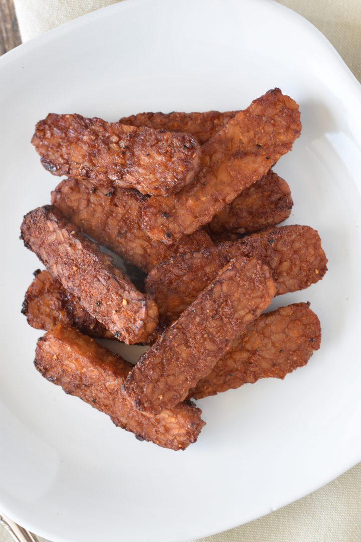 Overhead of tempeh on white plate