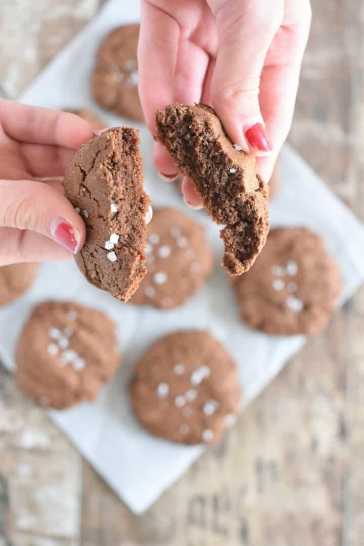 Breaking one of the cookies in half