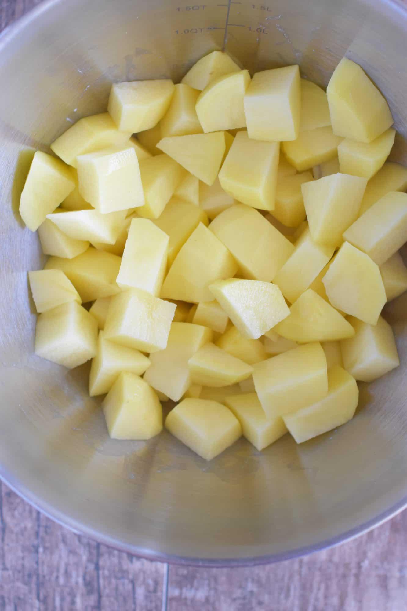 potato chunks added to mixing bowl
