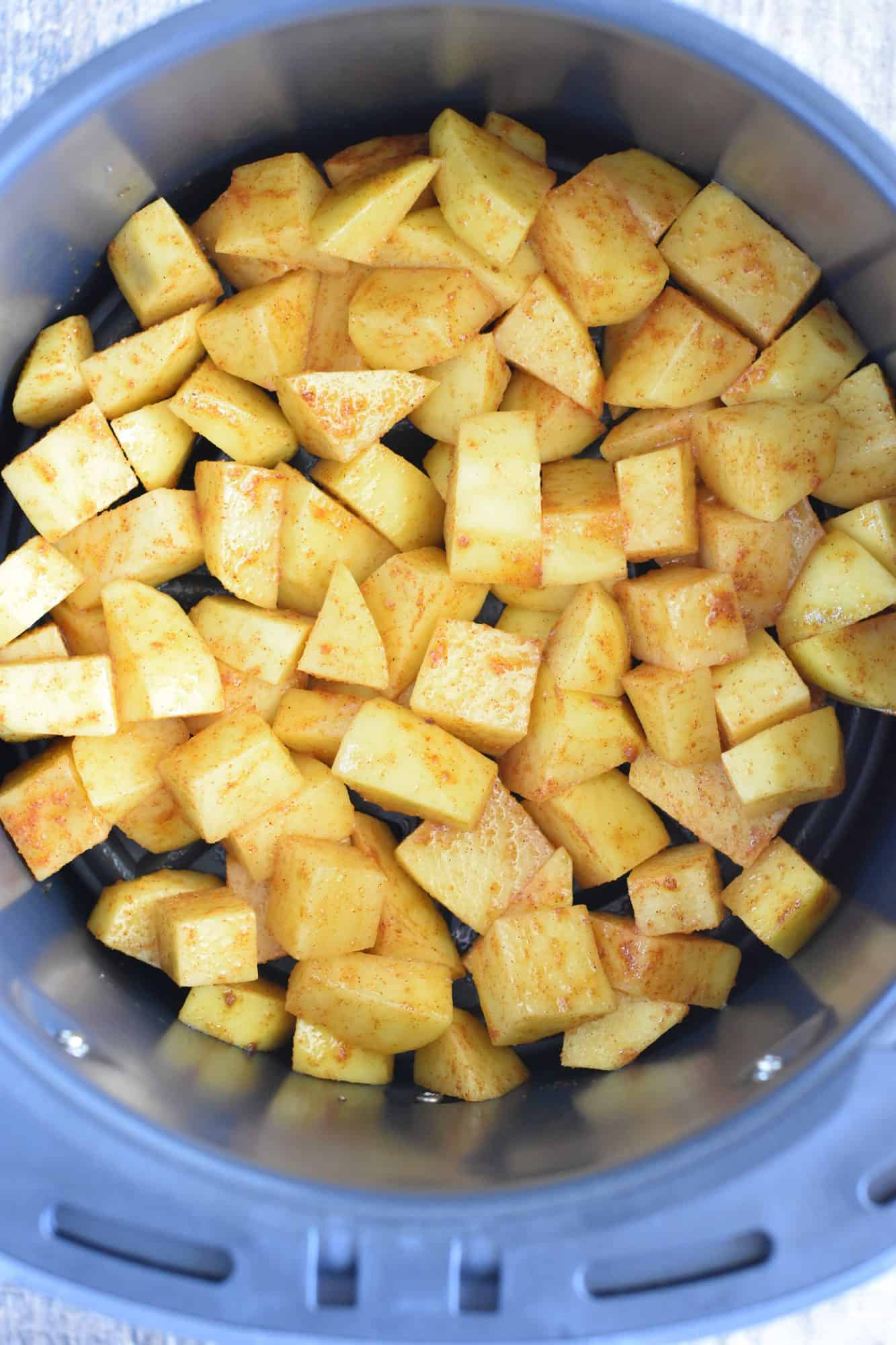 potatoes added to the air fryer before cooking
