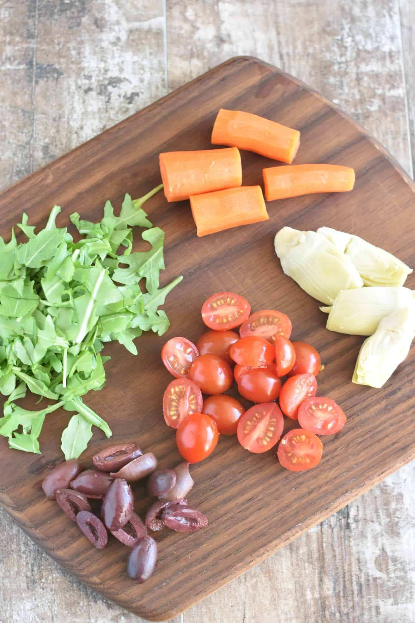 some of the ingredients on a wooden cutting board