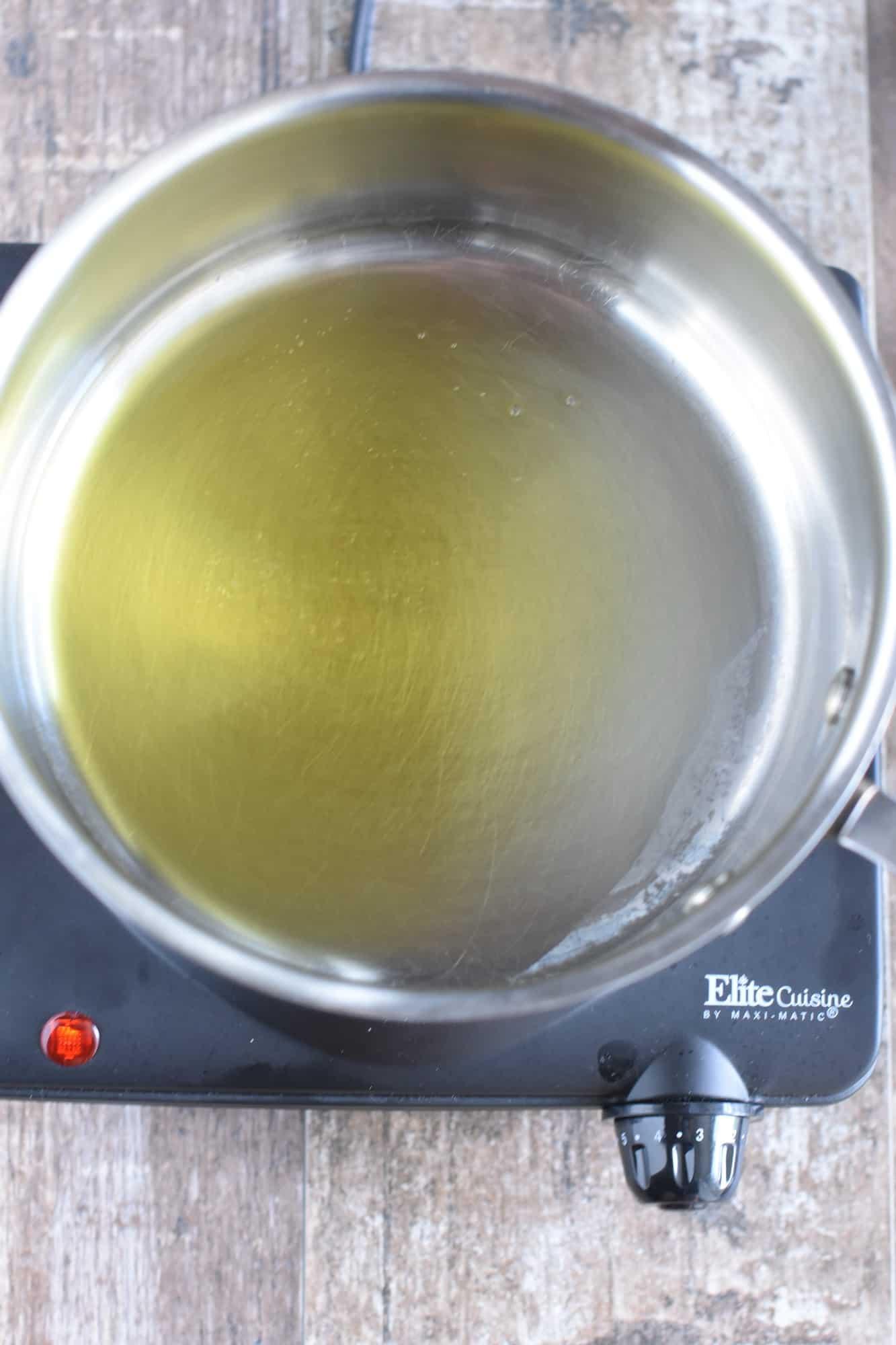 Heating olive oil in saucepan