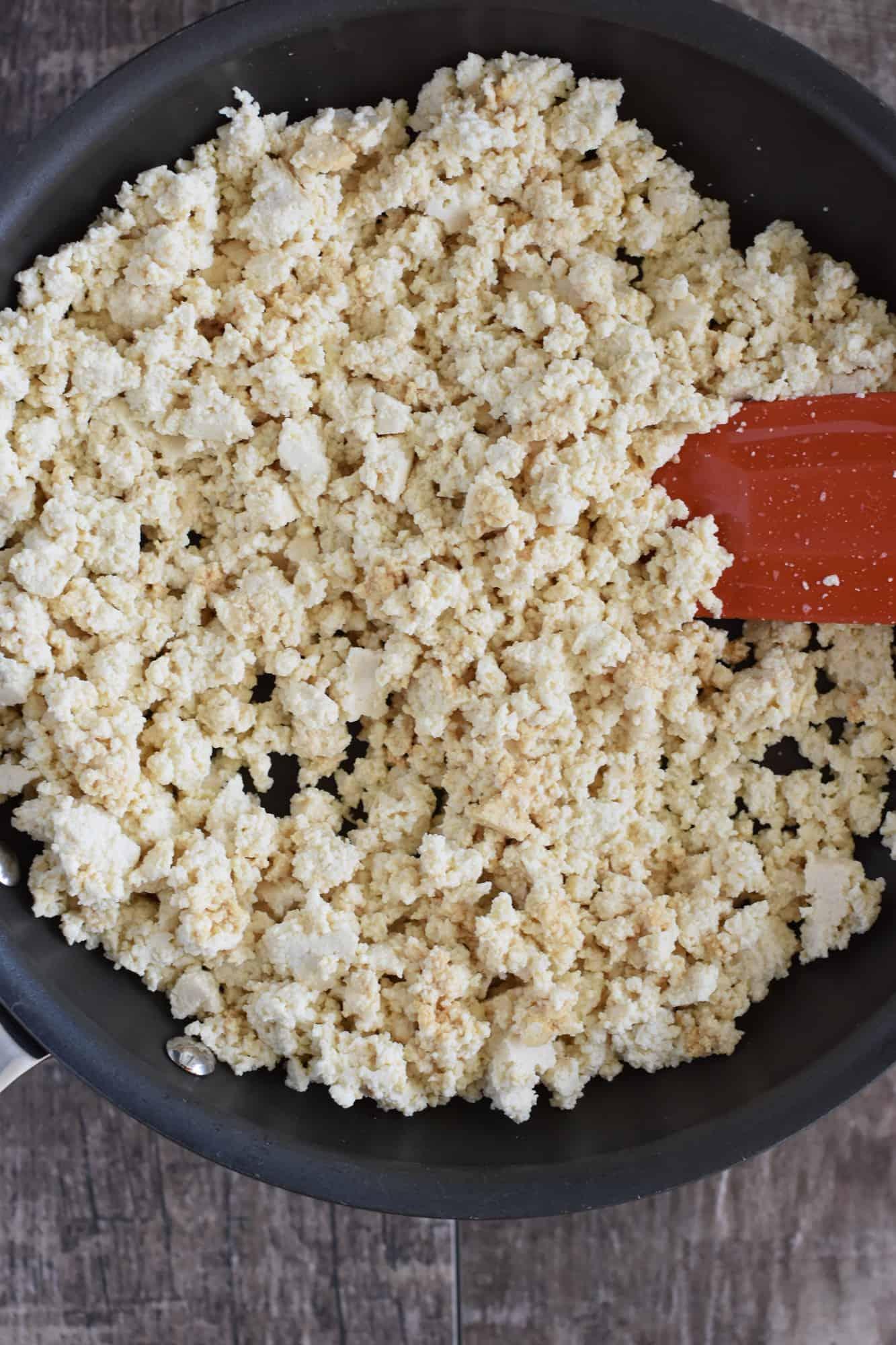 stirring the tamari into the crumbled tofu