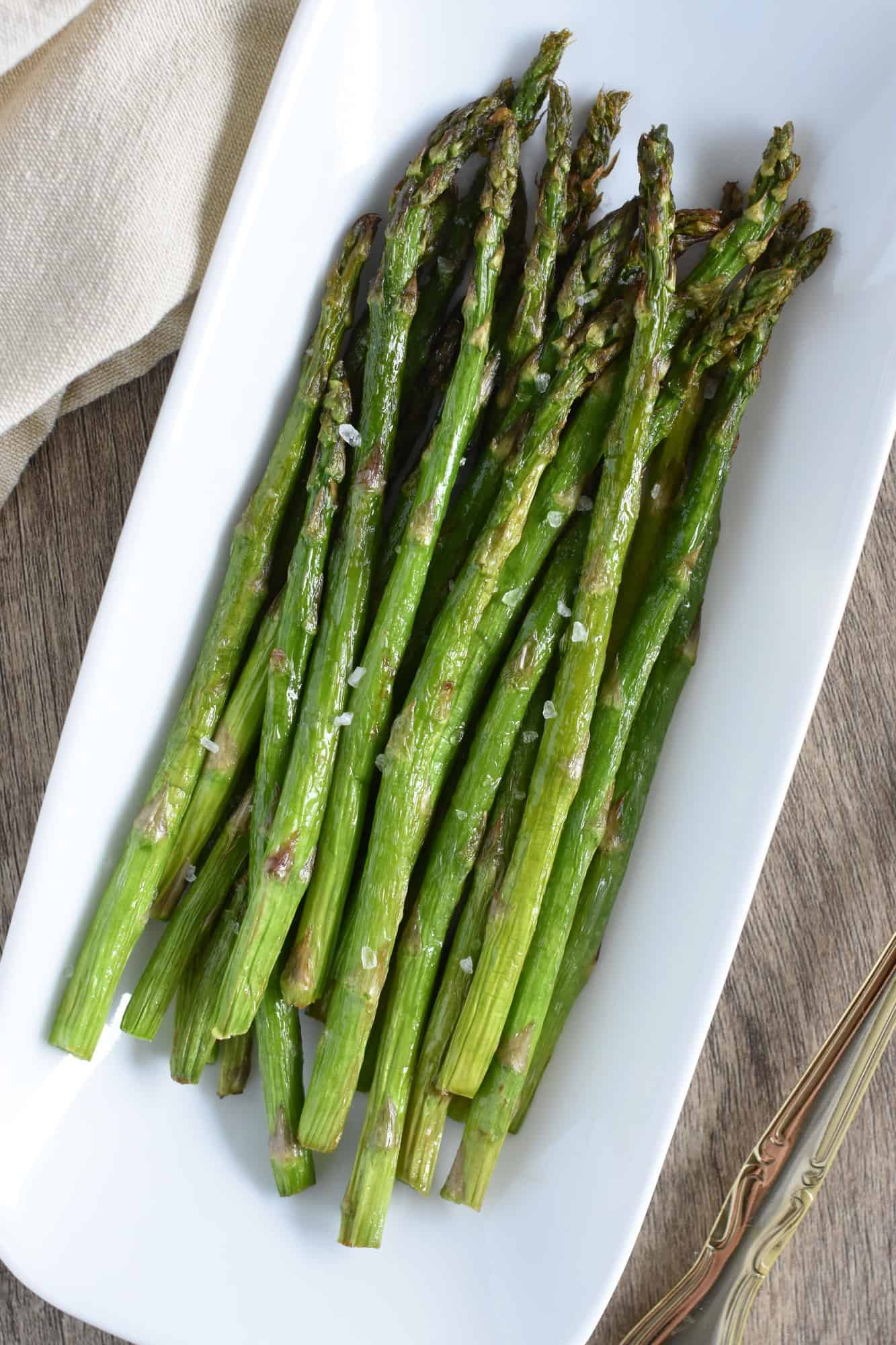 asparagus on white serving plate
