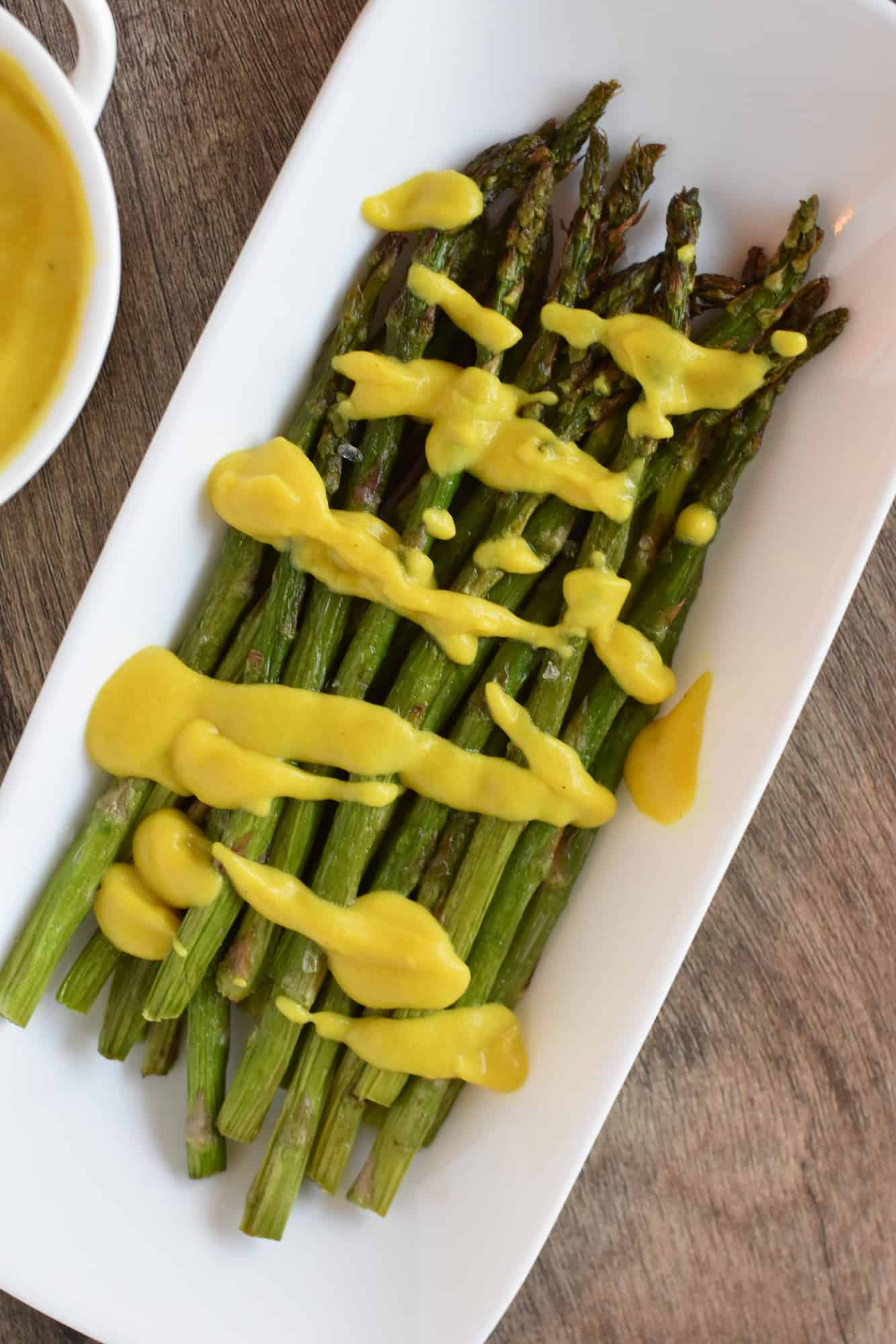 asparagus topped with vegan hollandaise