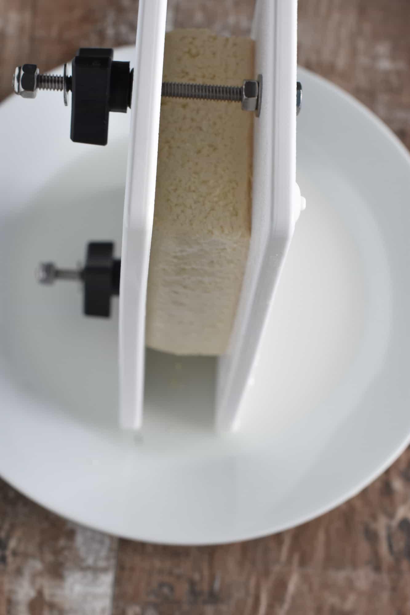 pressing tofu with a tofu press