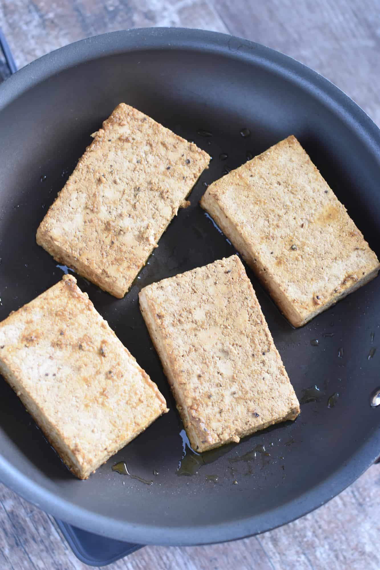 tofu cooking in pan