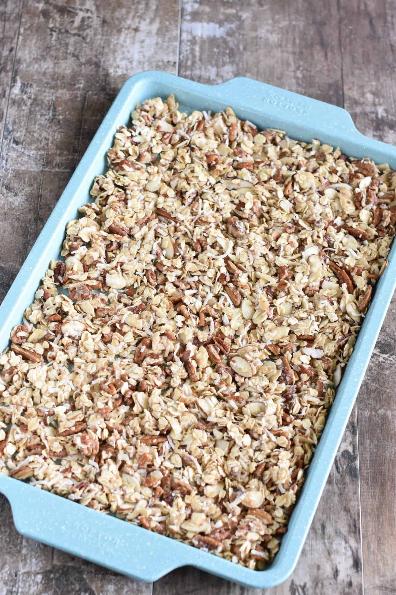 granola pressed down into one layer on baking sheet