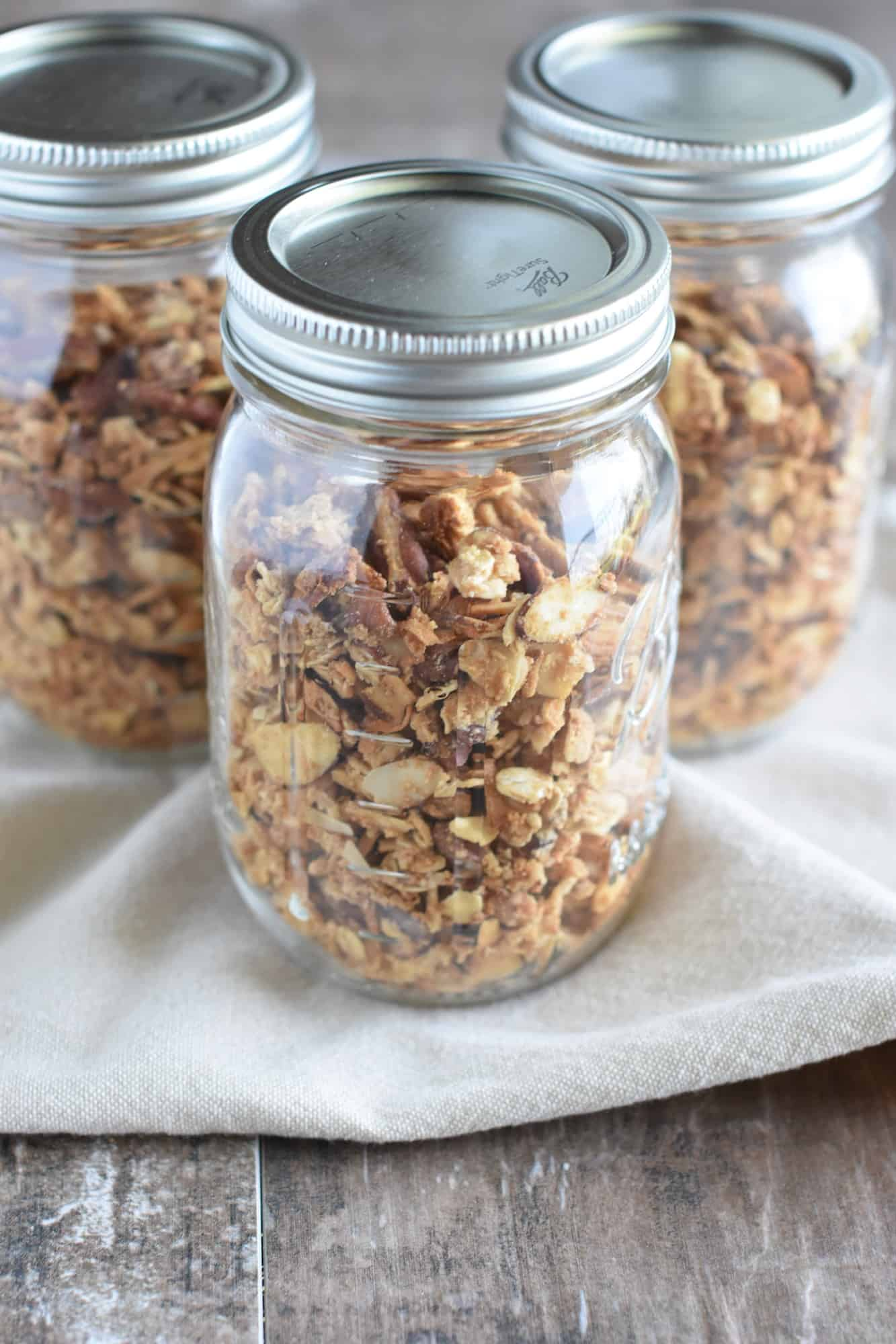 three sealed mason jars of granola