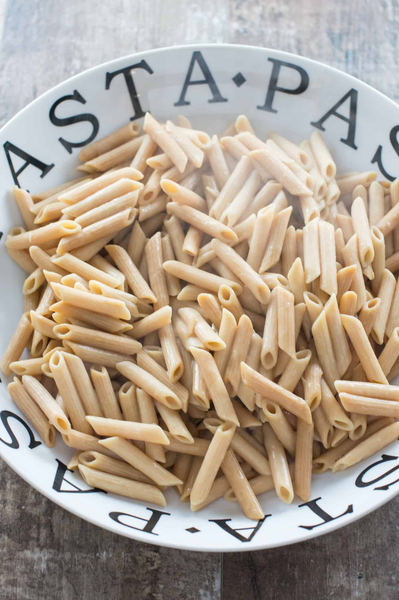 cooked pasta added to a large serving bowl