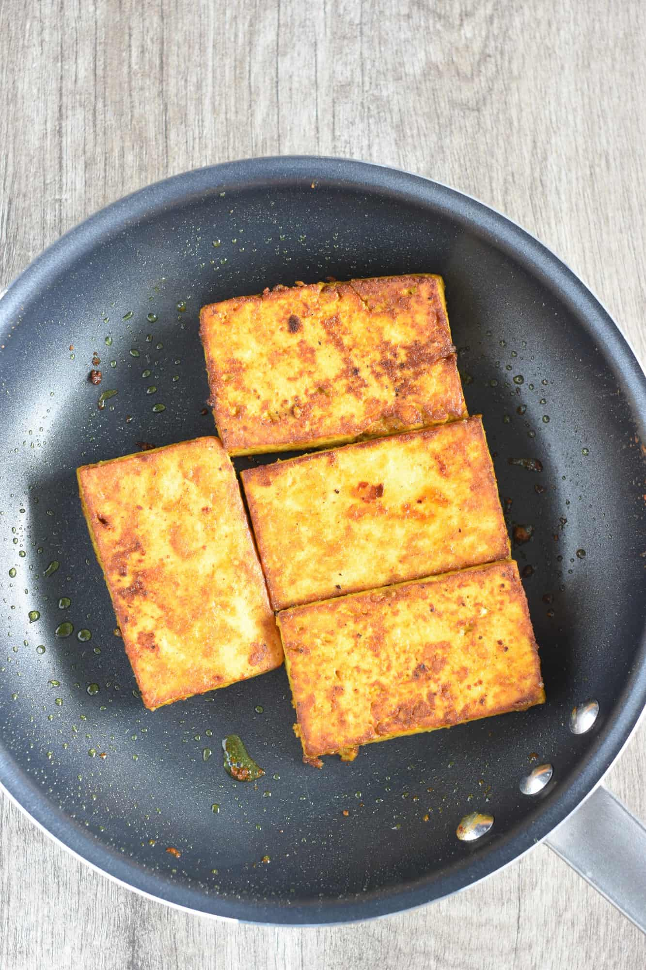 cooked tofu in a nonstick pan