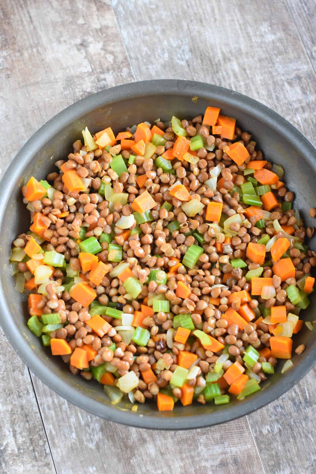 Lentils stirred into the veggie mixture in the skillet