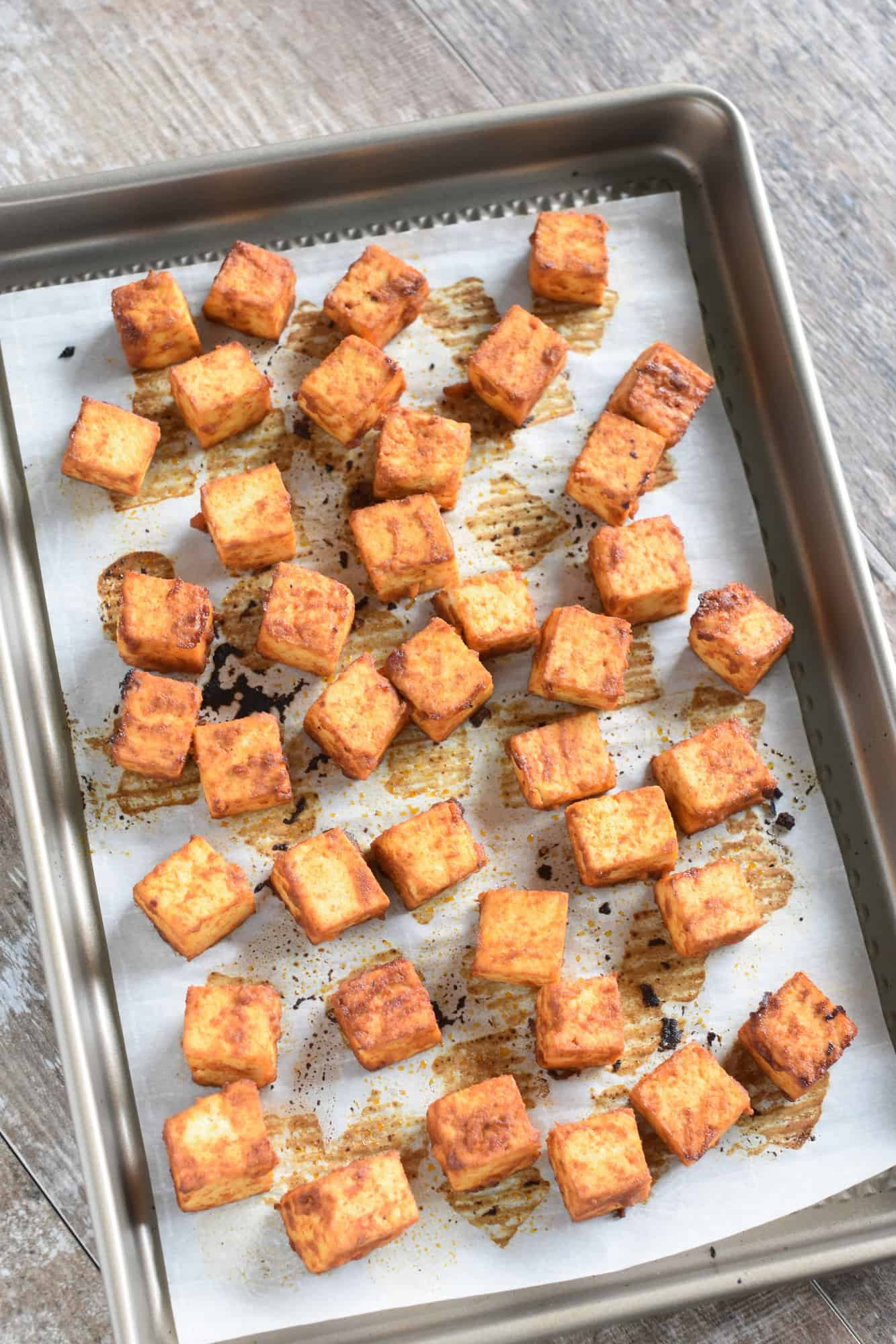 Tofu on baking sheet after being cooked