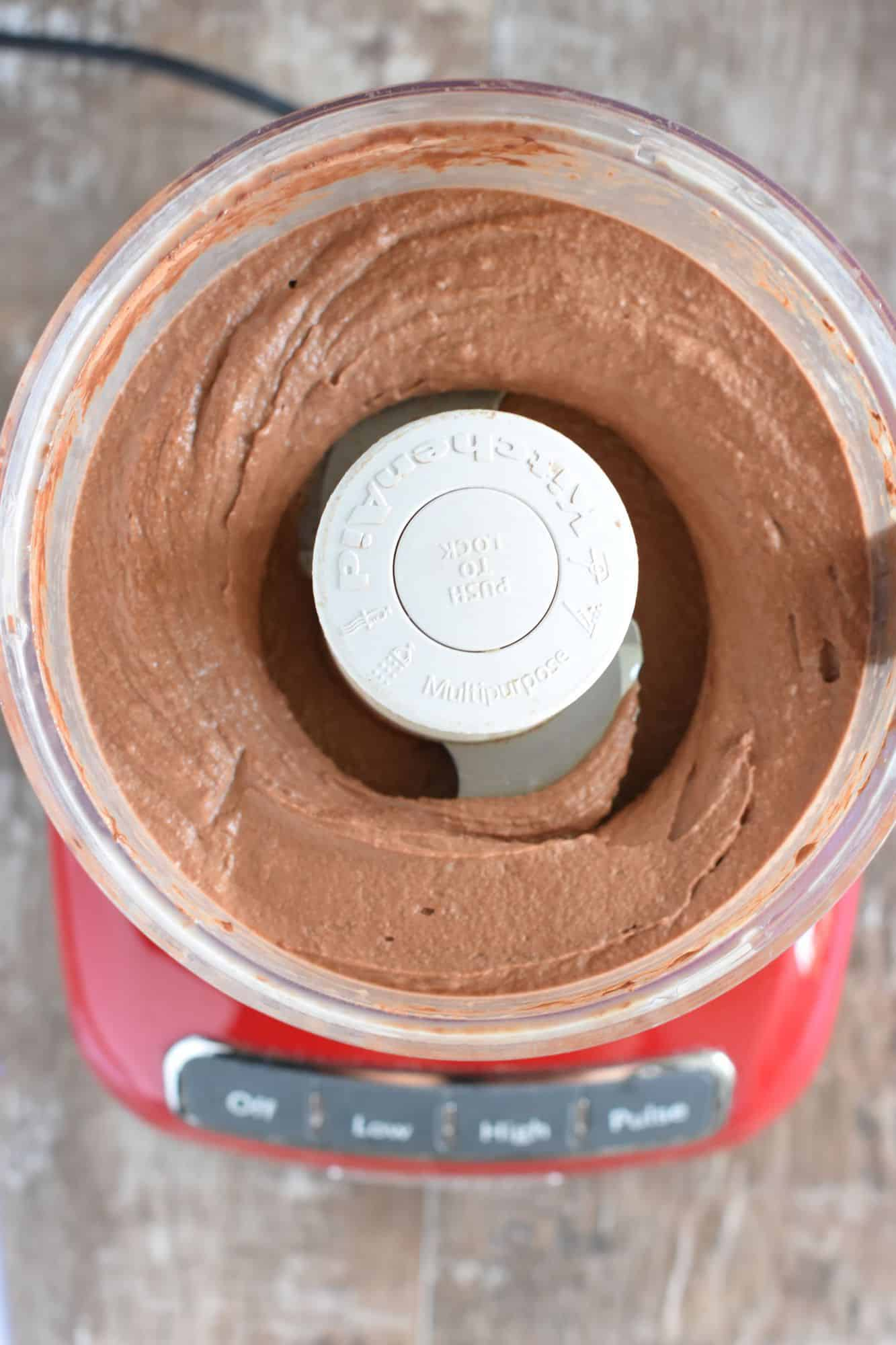 bananas, milk and cacao powder blended together in food processor