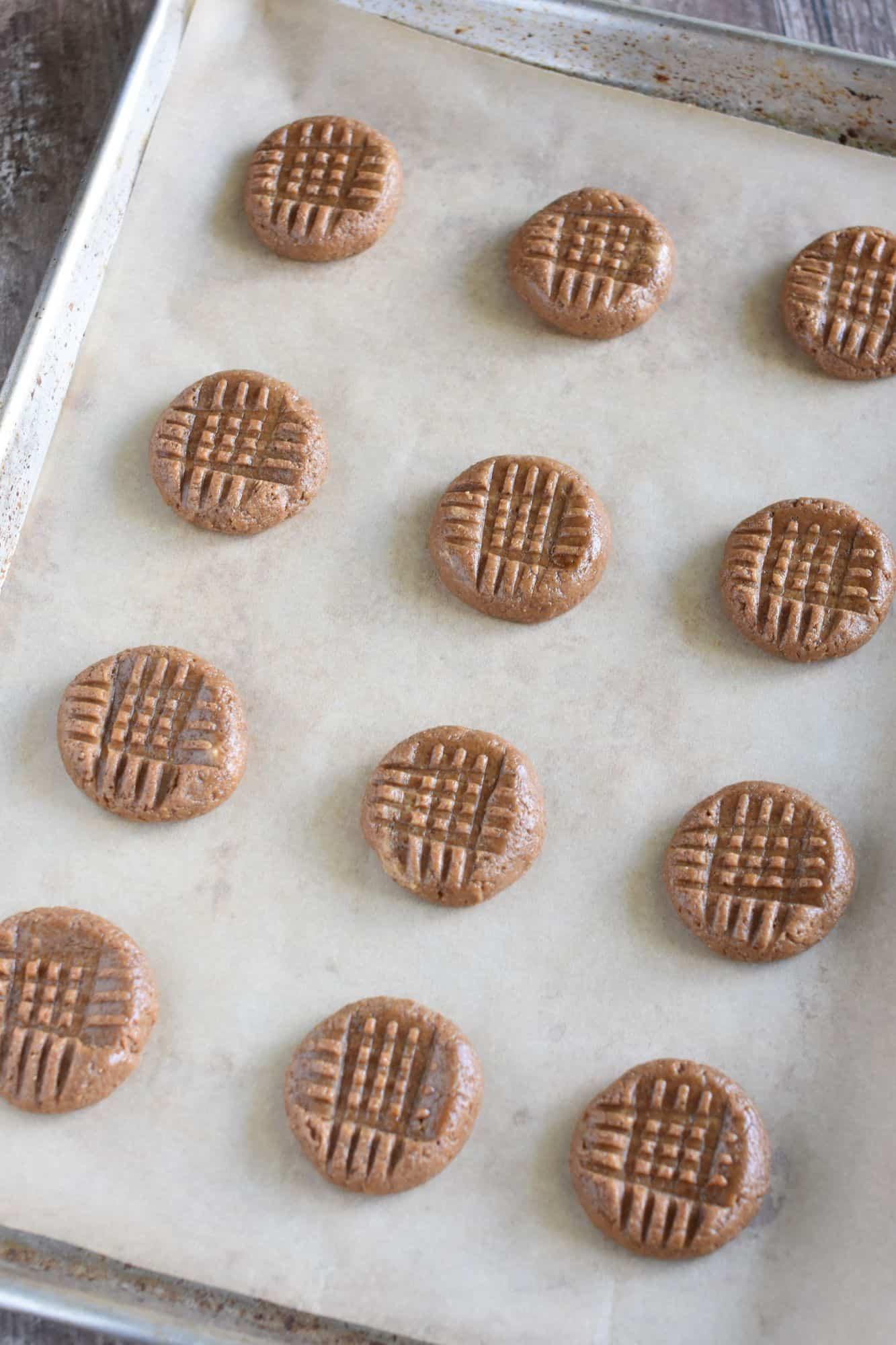 unbaked cookies on baking sheet