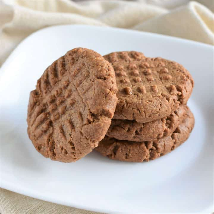 4 cookies on a white plate