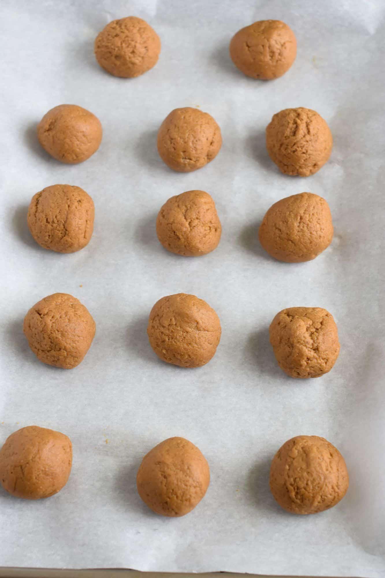 dough balls on a parchment-lined cookie sheet