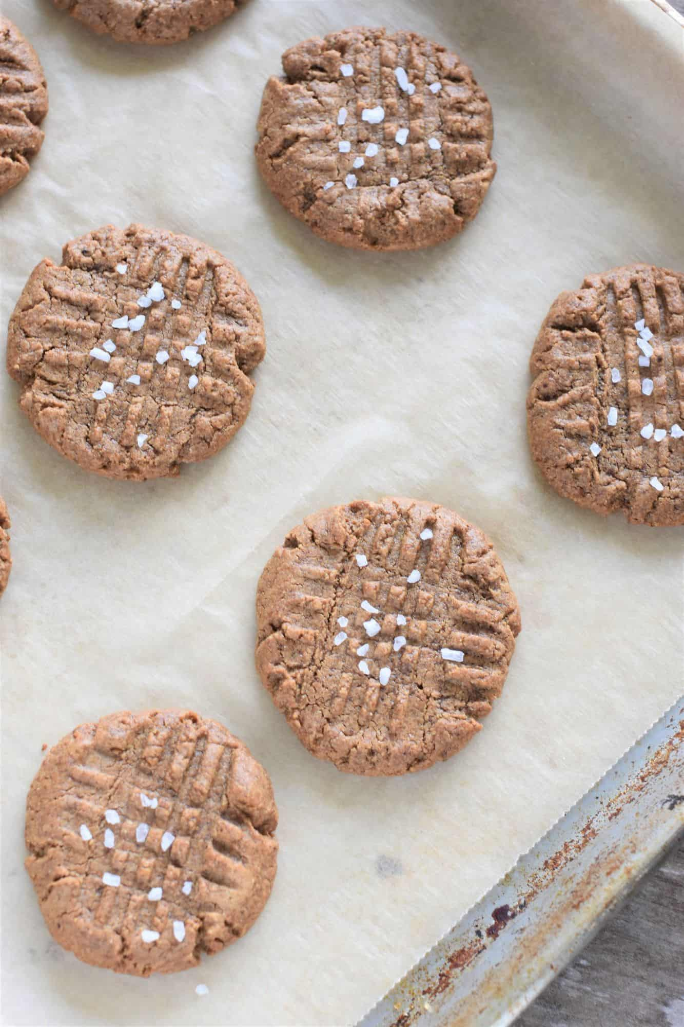 sea salt added to cookies on baking sheet after being baked