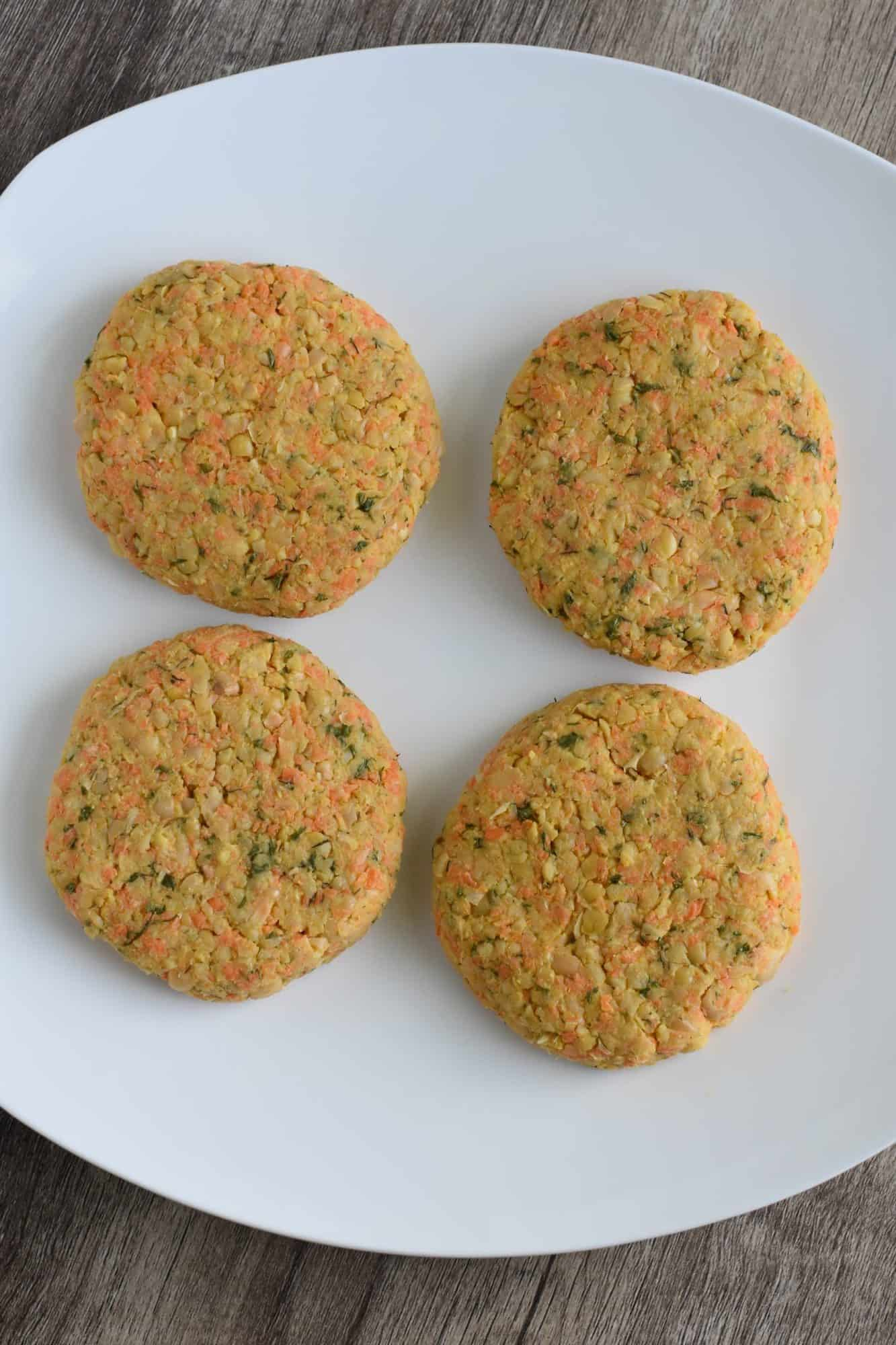 4 uncooked chickpea patties on plate