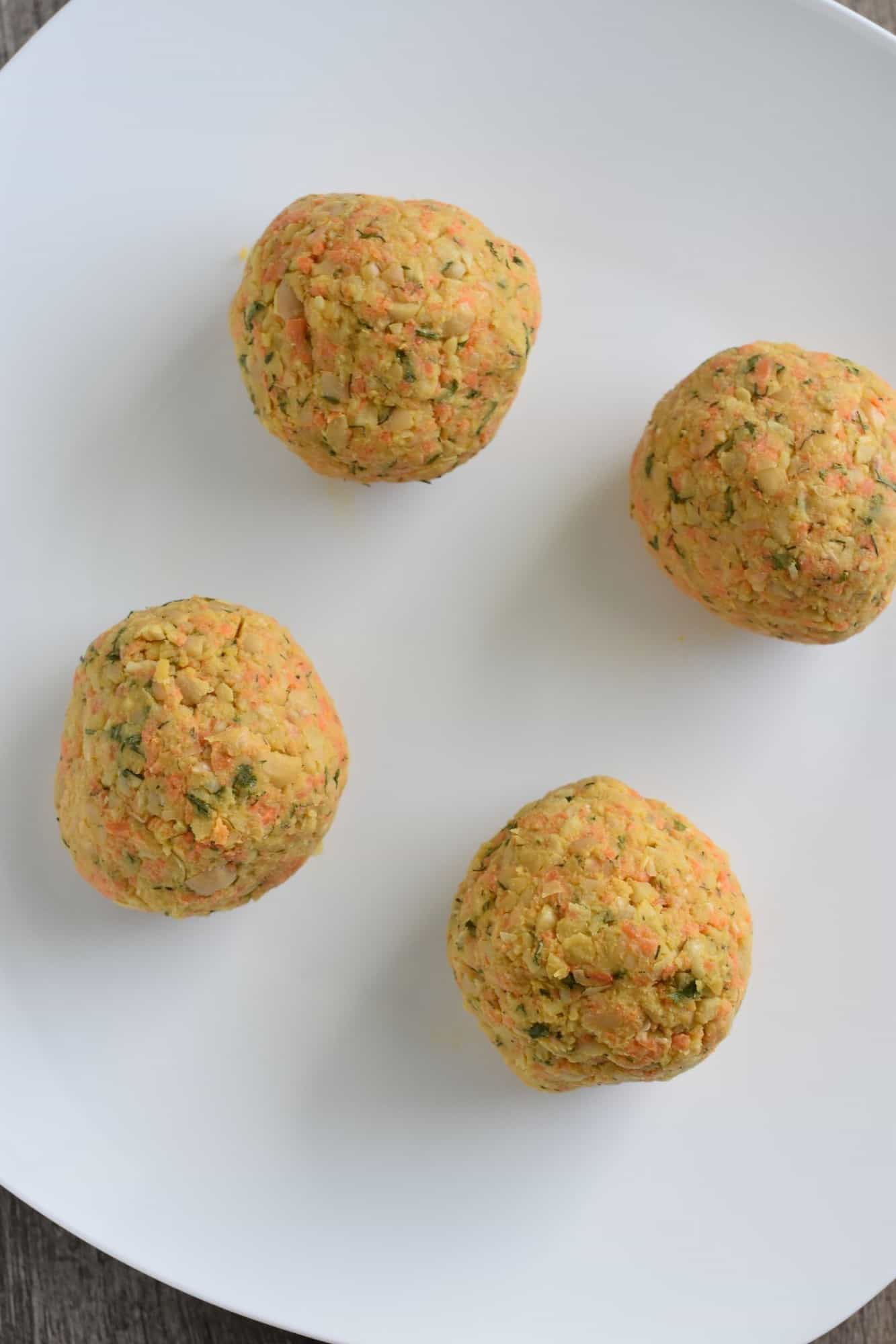 chickpea mixture formed into 4 balls of equal size