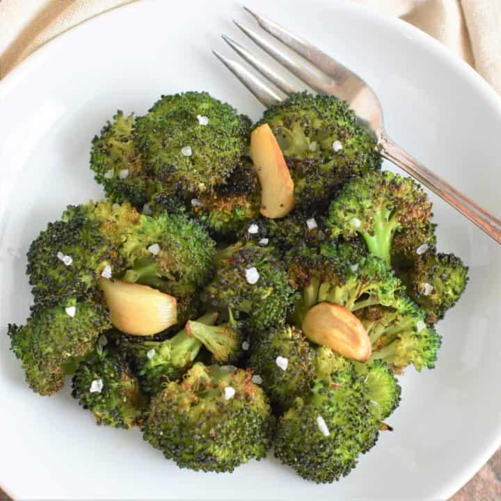 overhead of broccoli garnished with coarse sea salt
