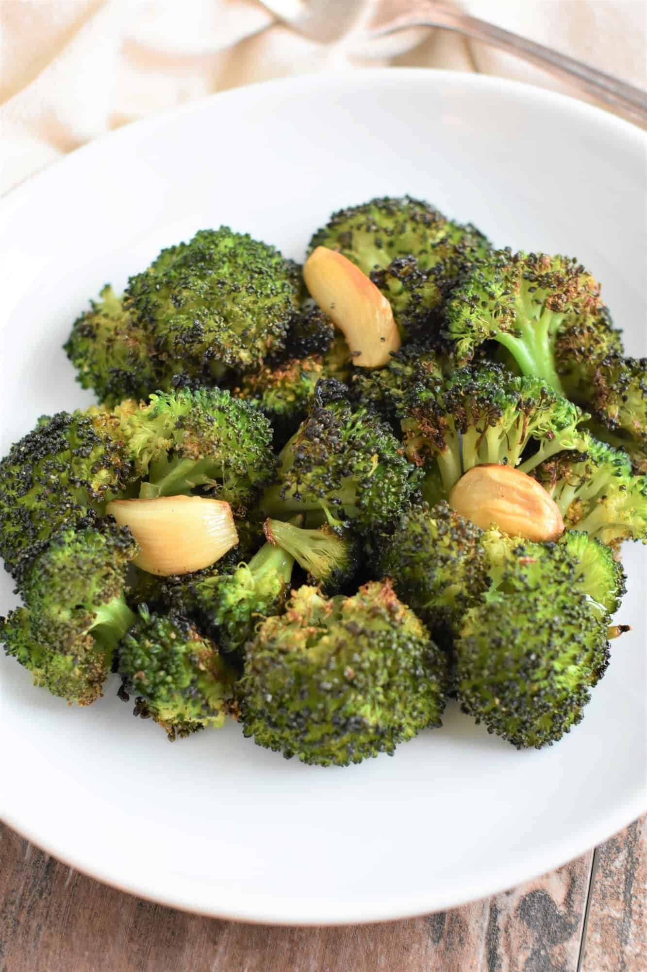 broccoli and garlic on white plate