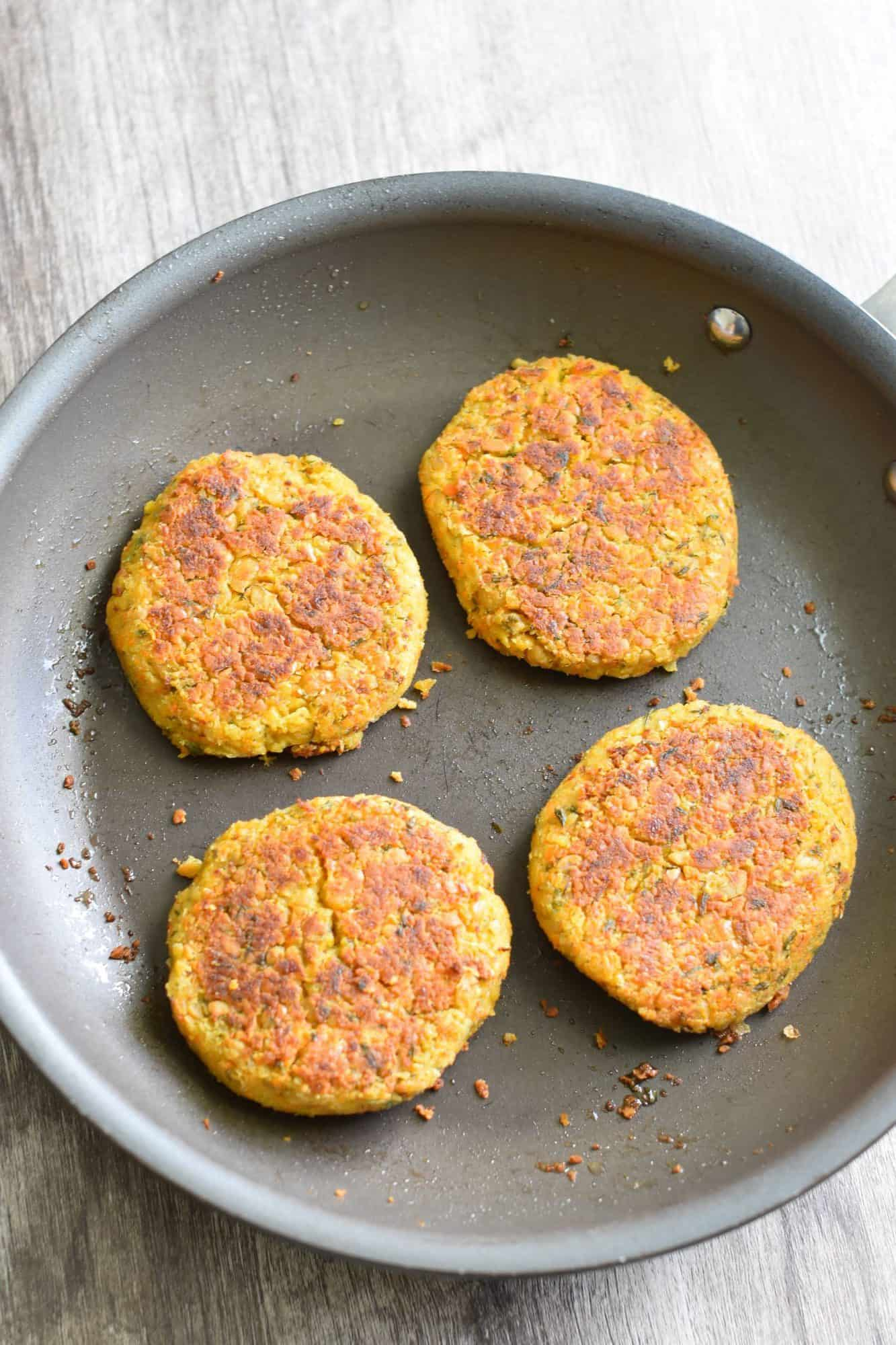 cooked burgers in skillet