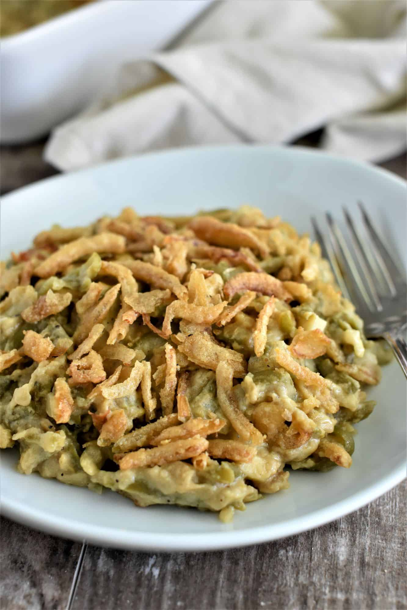 front view of vegan green casserole on white plate