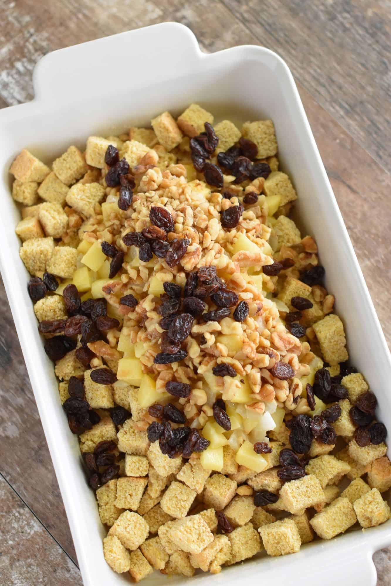 walnuts and raisins added to casserole dish