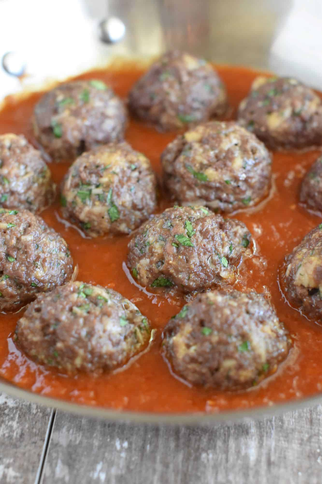 front view of meatballs in skillet in sauce