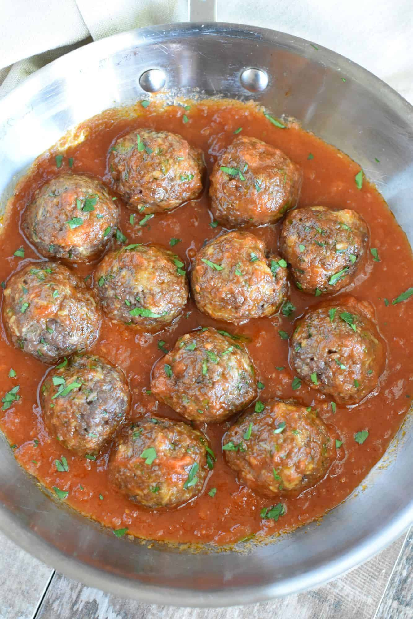 overhead of Italian-Style Impossible Burger meatballs in skillet with sauce