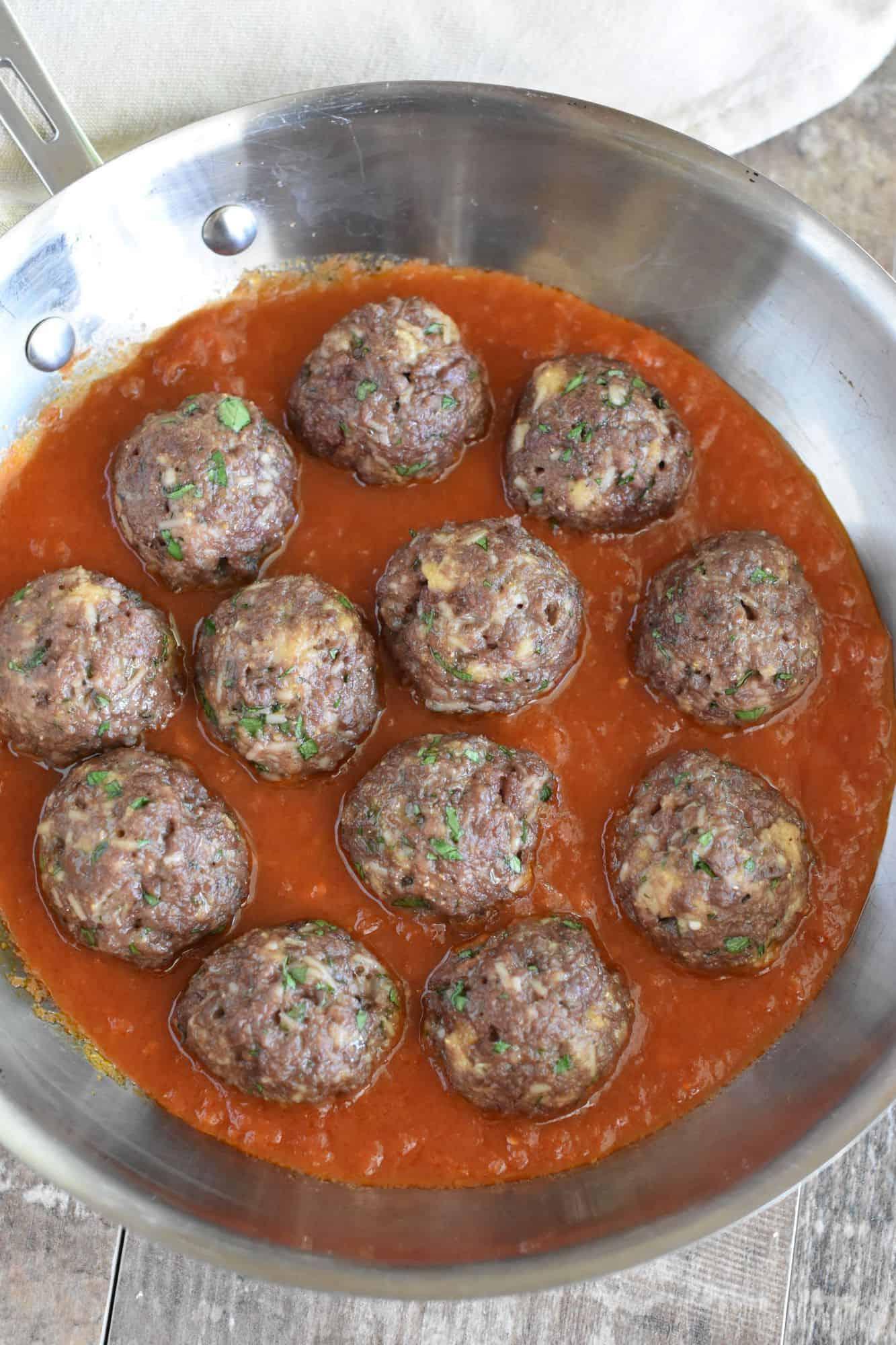 overhead of meatballs in skillet in sauce
