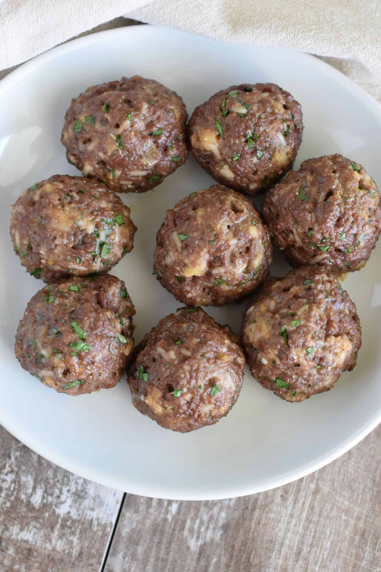 overhead of meatballs on a white plate with no sauce