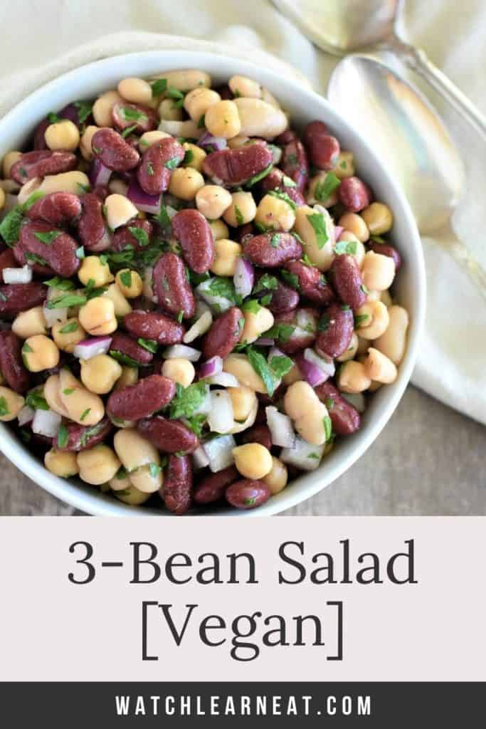 pin showing 3 bean salad in white bowl with spoons next to it