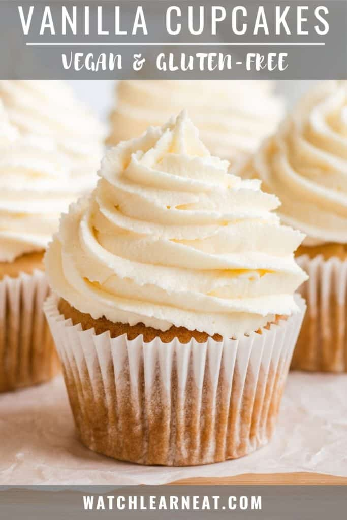 pin showing close-up front view of cupcake with frosting with some more in the background