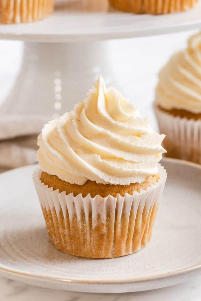 close-up of one frosted cupcake on a plate