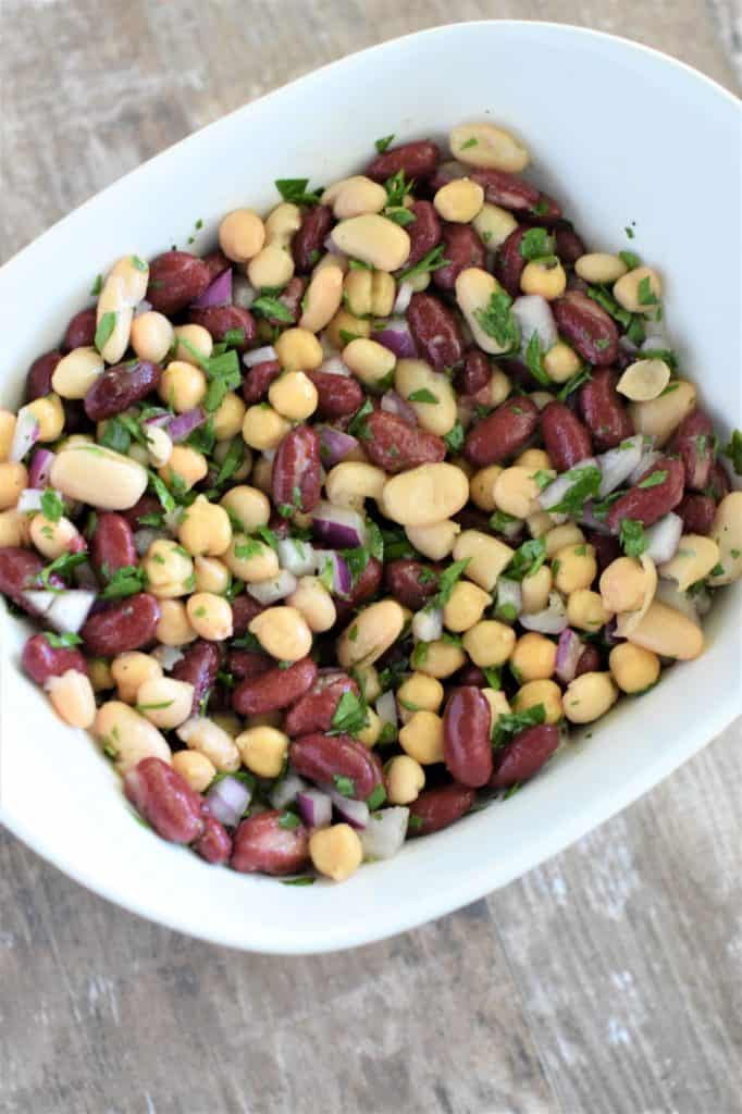 bean salad after mixing in white mixing bowl
