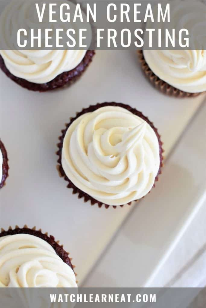 pin showing overhead of frosting on red velvet cupcakes