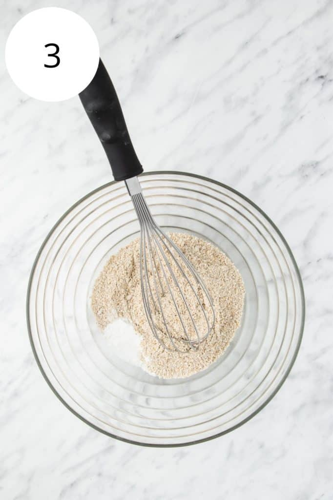oat flour, baking powder, baking soda and salt in a mixing bowl with a whisk