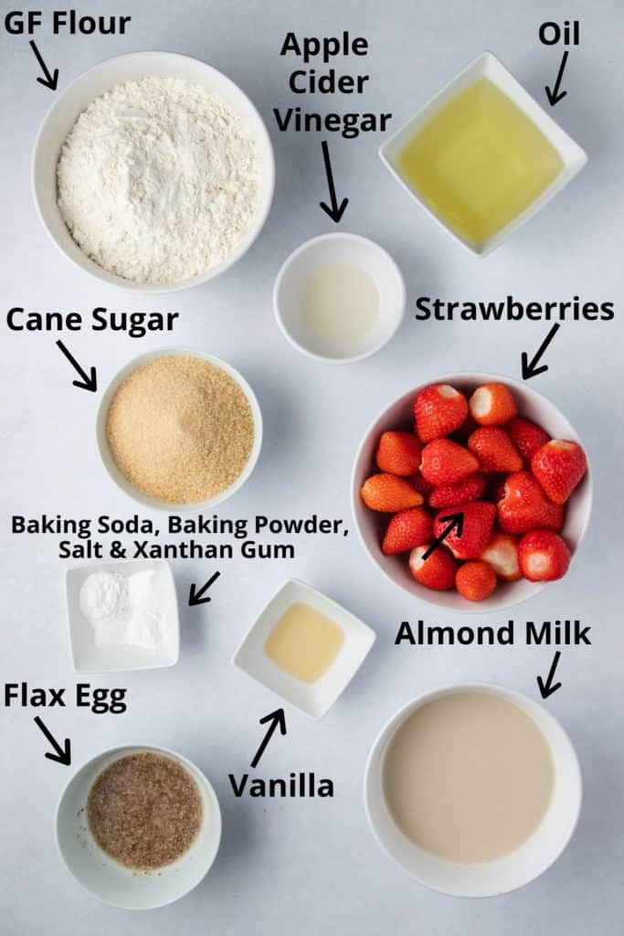 overhead of ingredients for cake in white bowls with text labels