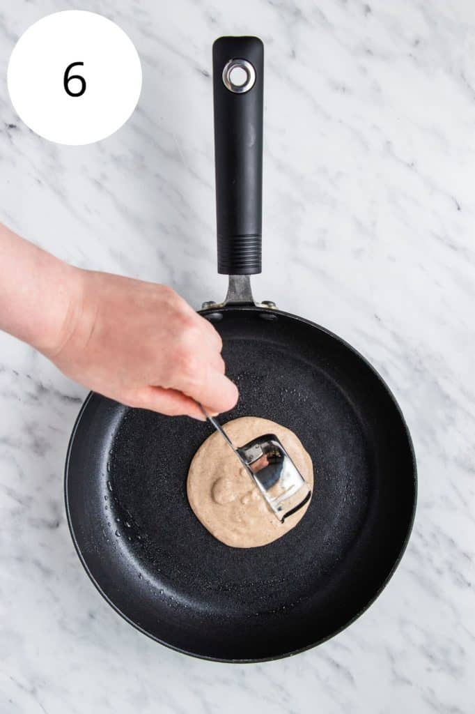 pouring batter into a hot pan