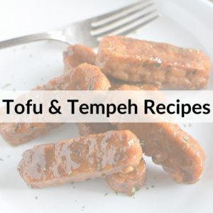 photo of tempeh with text title overlay Tofu & Tempeh Recipes
