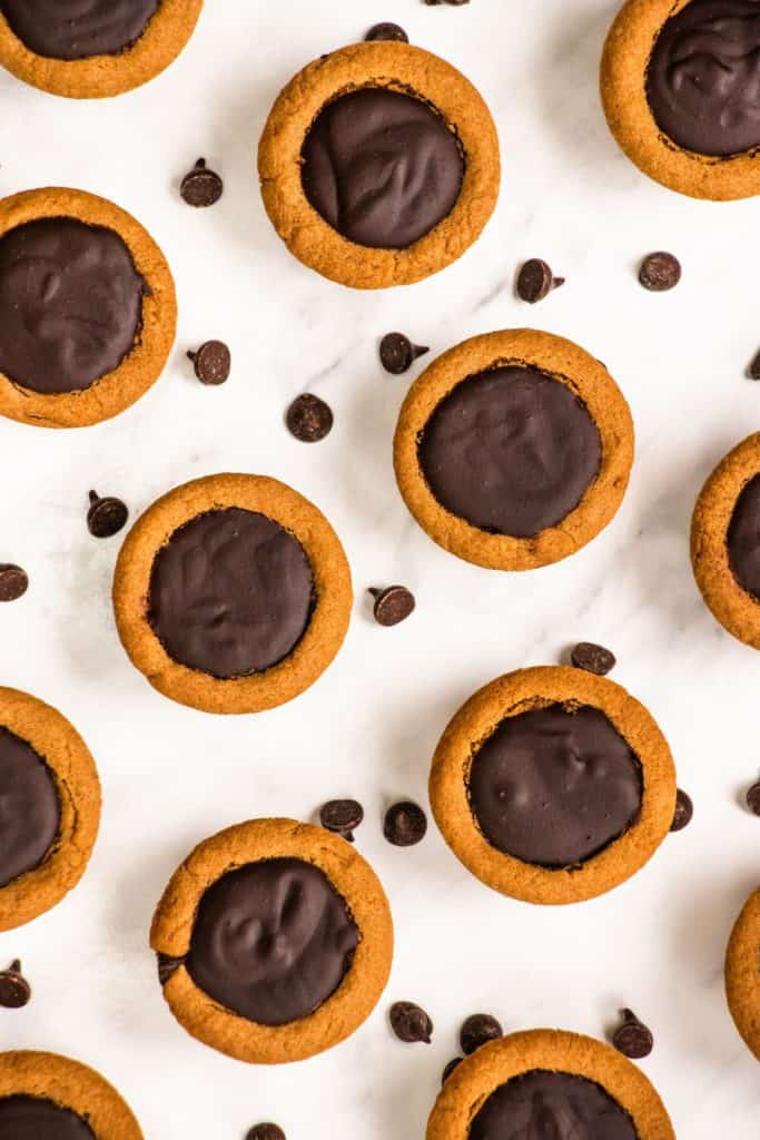 overhead of cookie cups with chocolate chips around them