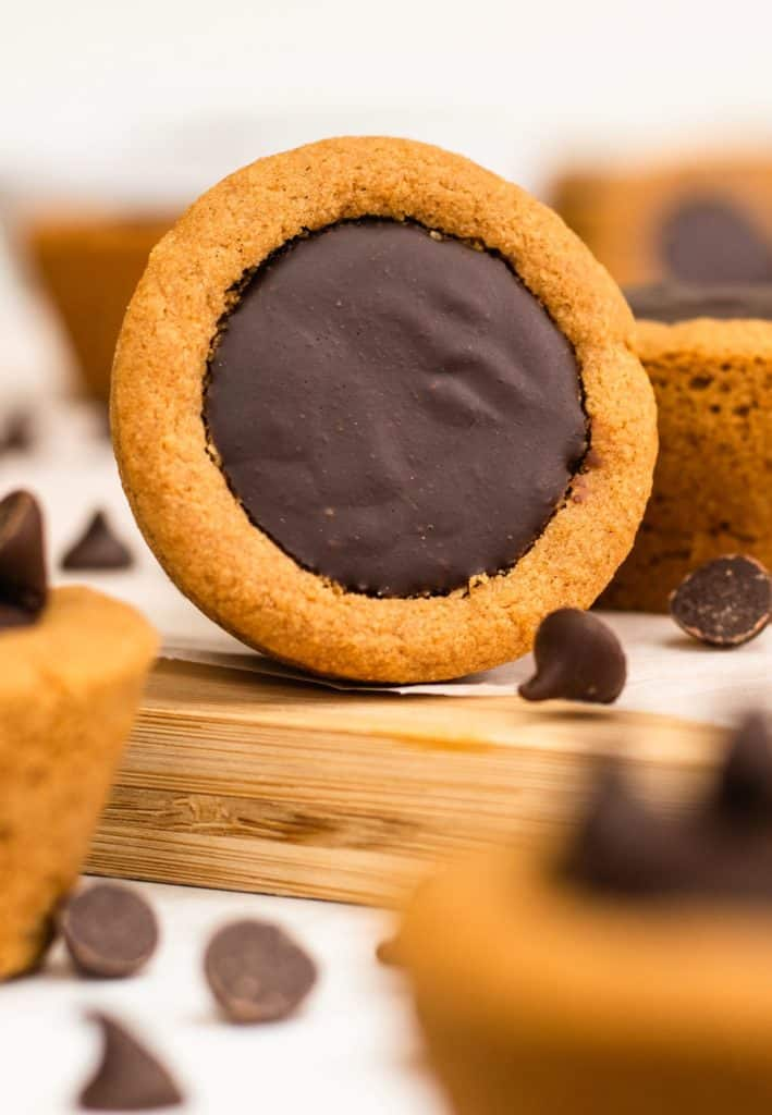 cookie cup on its side to show chocolate filling