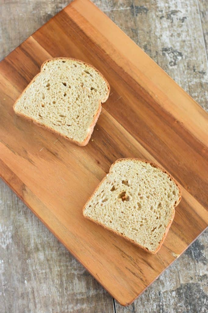 two slices of lightly toasted bread on wooden board