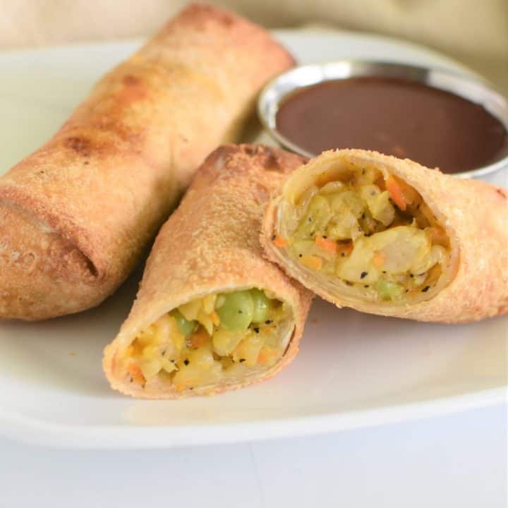 close up of air fryer egg rolls on a white plate