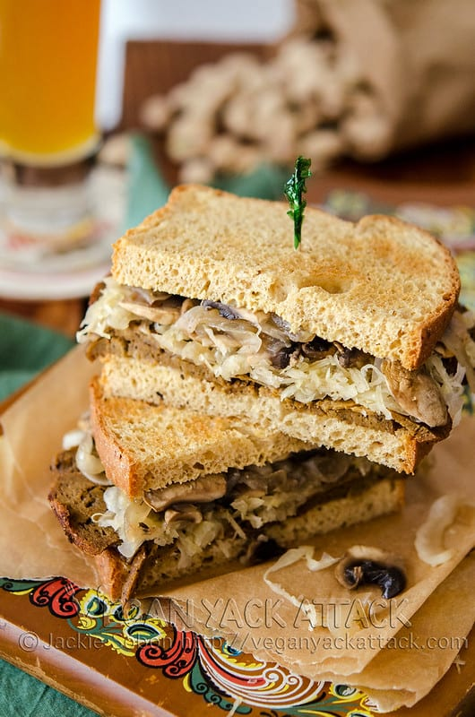 seitan and sauerkraut sandwich stacked with toothpick in top half