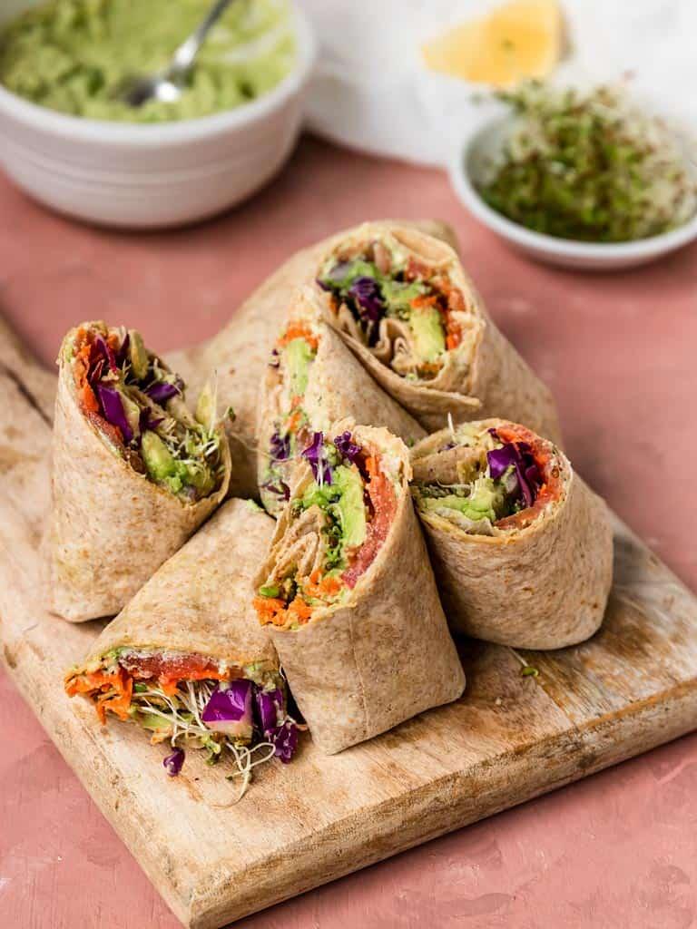 edamame hummus veggie wraps on a wooden board