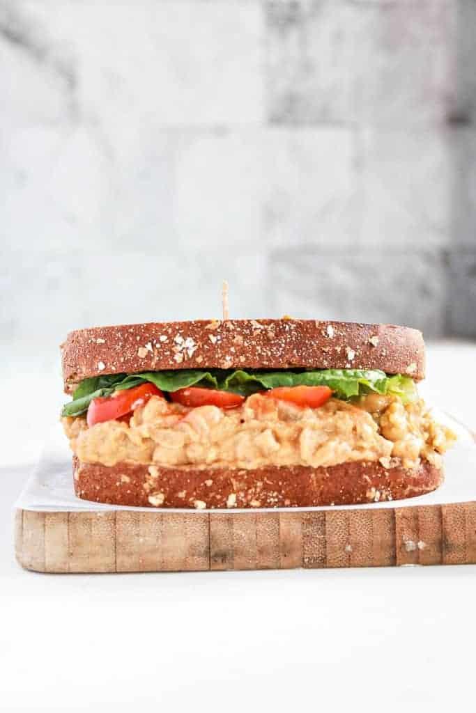 Buffalo chickpea sandwich on wooden board
